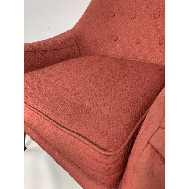 Chair is a nice samen color, very nice lines and low to the ground. Very hard chair to find