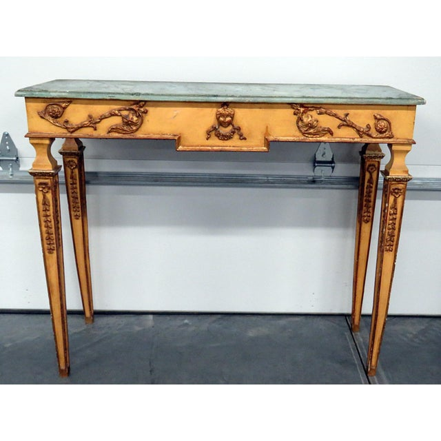 Neoclassical style distressed painted faux marble top console table with matching wall mirror. The console table measures...