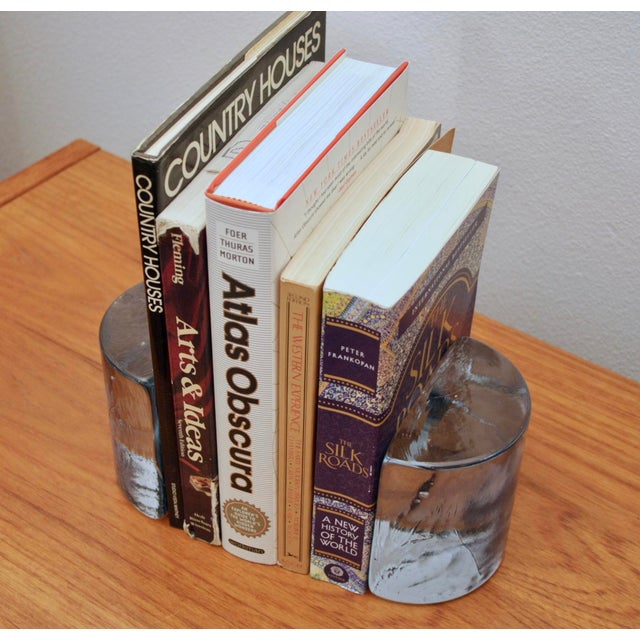 Beautiful, icy cool, solid Blenko glass bookends. Great sculptural objects that happen to be functional, too. Just so so...