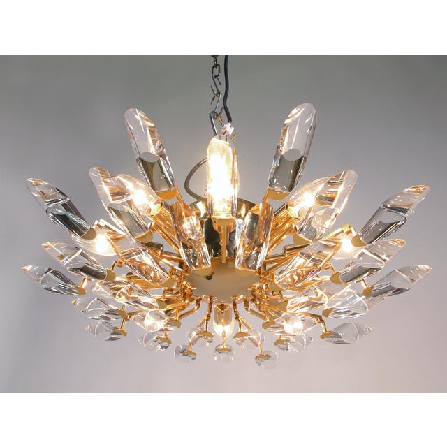 Elegant ceiling lamp with crystal glass on a gold-plated brass frame. Chandelier illuminates beautifully and offers a lot...