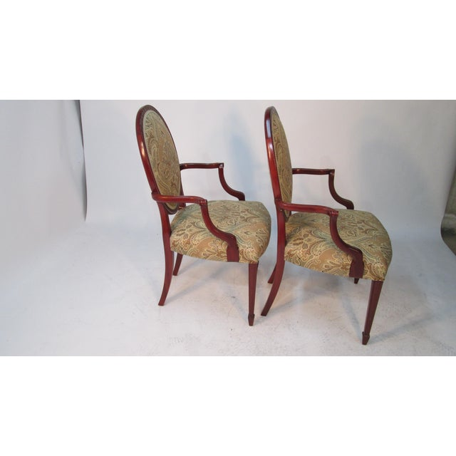 These are a match pair of arm chairs made by Joseph Gerte of Boston MA. The chairs are made of solid mahogany. There is...