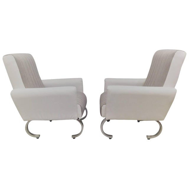 Mid-Century Exclusive Pair of Sleek Italian Armchairs With Curved Metal Base For Sale