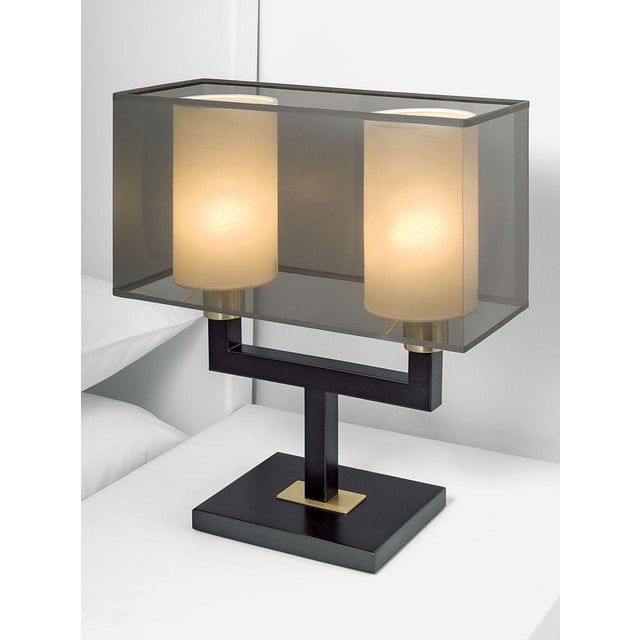 A black bronze lamp with contrasting accents in English brass. The square section arms support twin lamps with smoke...