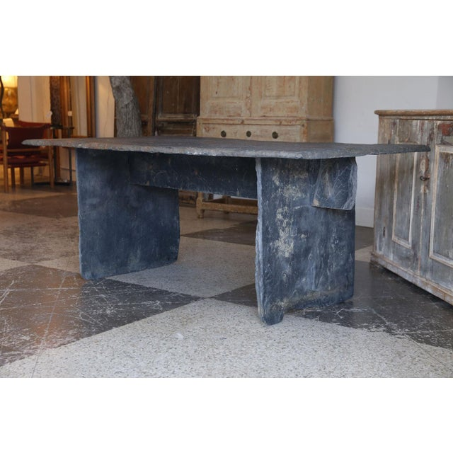 Long slate center table, or console, with rectangular heavy, thick slate top with three-piece slate trestle base. Can be...