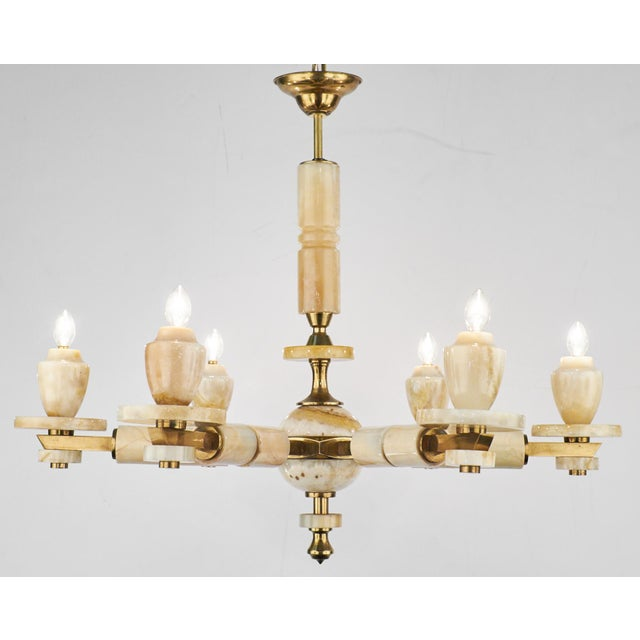 Mid-century vintage onyx and brass chandelier from Italy. A timeless piece that creates a stunning balance of materials...