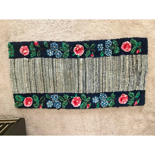 This is a very fine antique hooked rug in great condition. Over the years I've washed it in the machine on gentle cycle,...