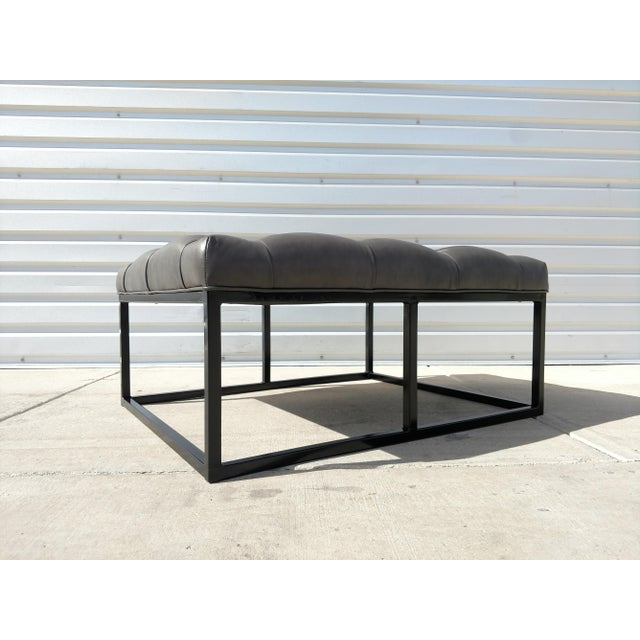 Brand new West End Leather Ottoman. Metal Frame with black finish. Gray full grain leather upholstered top. Made in USA.