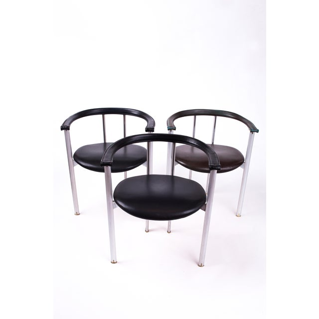 Antonio Citterio (b. 1950) Striking set of three unusual Minimalist steel and black leather armchairs by Antonio Citterio...