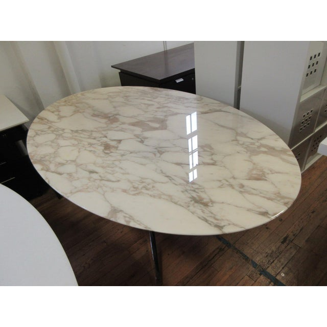 This iconic Florence Knoll oval marble table was manufactured in 2005 and is in really nice condition. Top is calacatta...