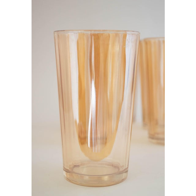 The brilliant iridescent finish in Marigold (peach color) on these flat tumblers in the 'Optic Pillar' pattern makes them...