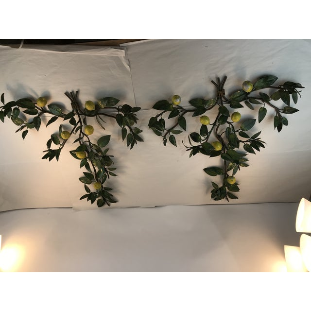 Tall pair of vintage wall sconces, made in Italy. Five lemons adorn each sconce and there are five candle holders if they...