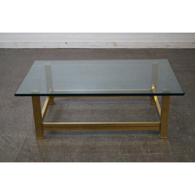 Store Item #: 14459-fwmr Mastercraft Brushed Brass & Glass Coffee Table AGE/COUNTRY OF ORIGIN: Approx 35 years, America...
