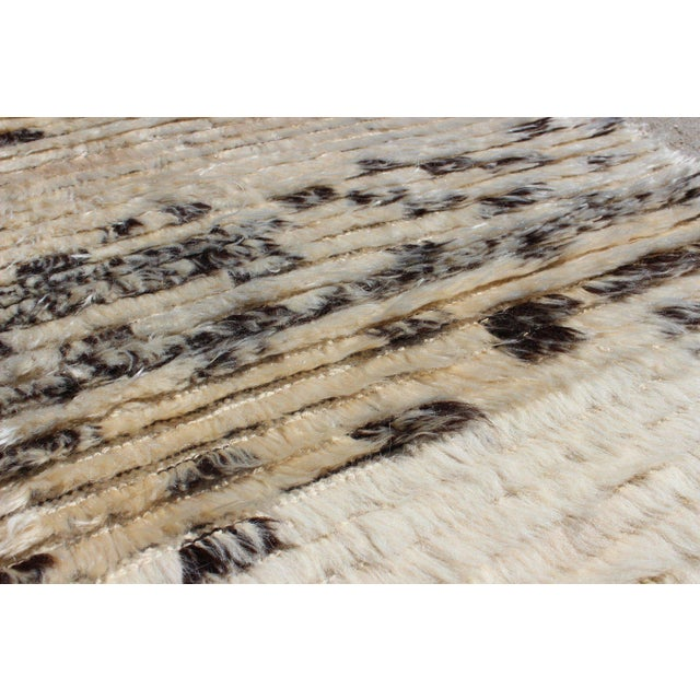 Natural lambs wool, goat hair and angora goat hair has been used to weave this new production contemporary style...