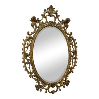 Antique Rococo Oval Mirror With Carved Gold-Toned Frame For Sale