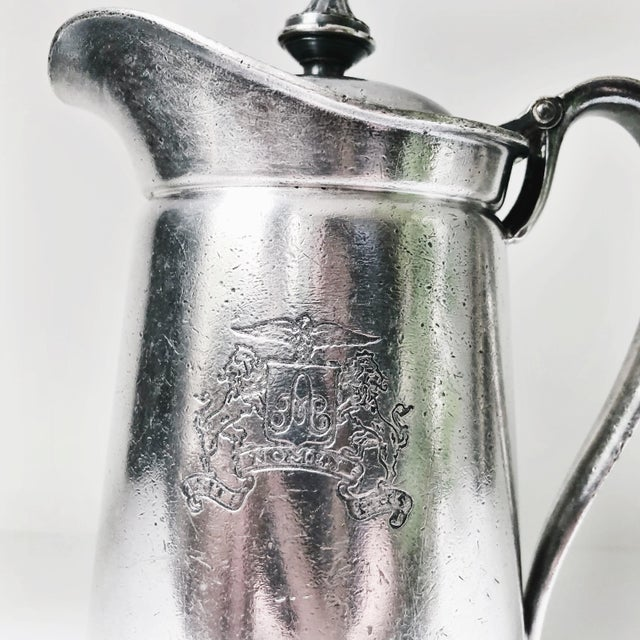 A beautiful vintage circa 1954 heavy silver plated insulated pitcher from the Ambassador Hotel in New York City! In great...