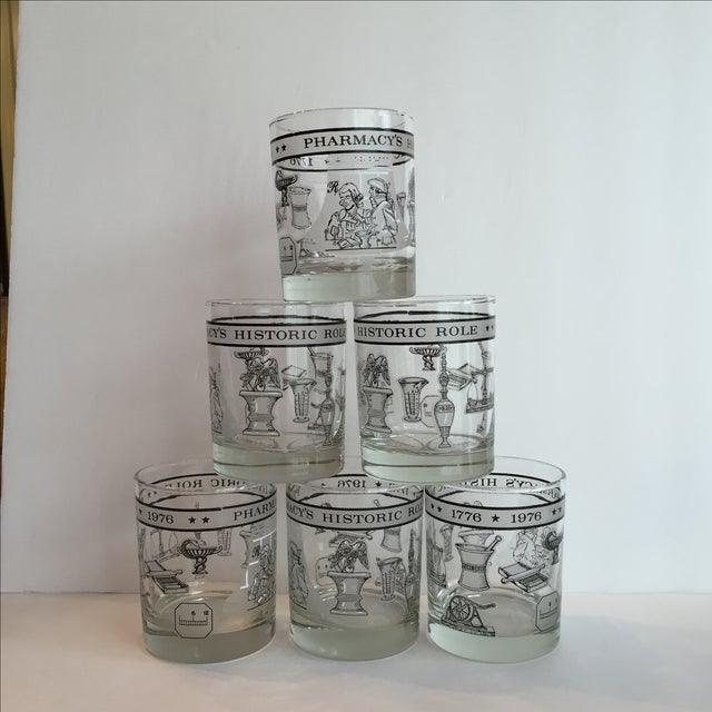 """Six cocktail glasses each with a printed banner reading, """"Pharmacy's Historic Role, 1776 - 1976,"""" plus ten pictures..."""