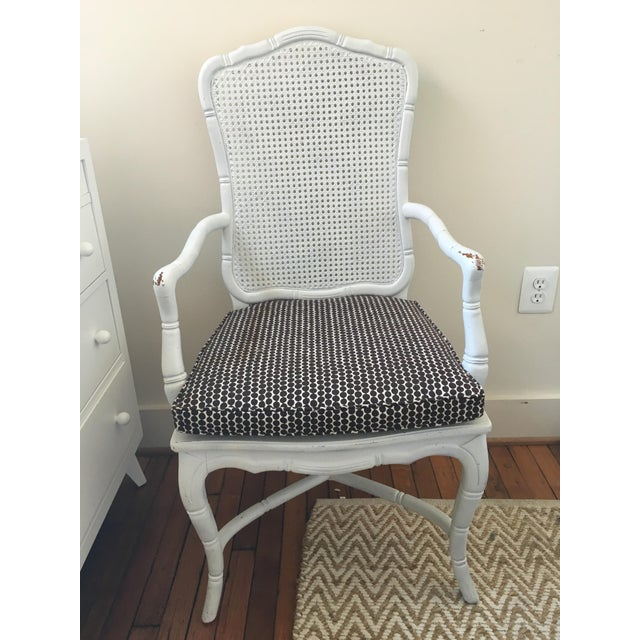 Faux Bamboo armchair in white-painted finish with a caned back and an upholstered custom cushion to fit. Cushion is Hable...