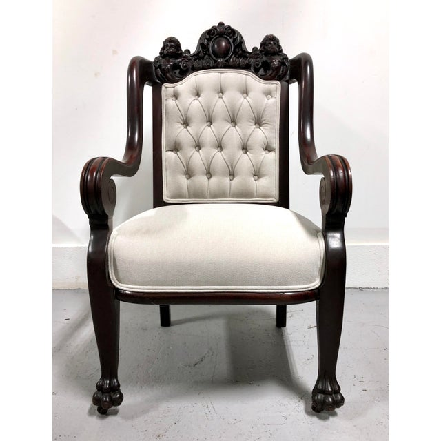 A dramatic antique piece with deeply carved cherubs and claw feet. Brand new high-end Knoll Haze upholstery in Ash...