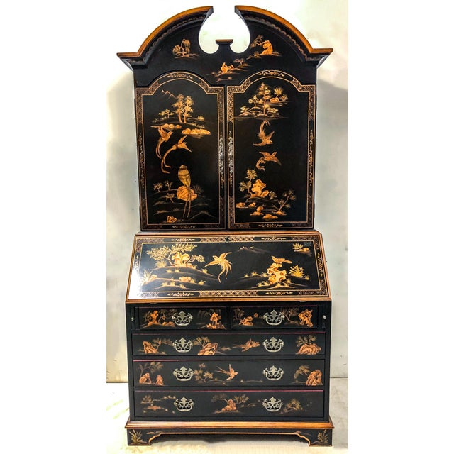 Vintage chinoiserie secretary with black lacquer and gilt japanned exterior, and red painted interior. It most likely...