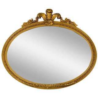 Horizontal Oval Carved Giltwood Mirror