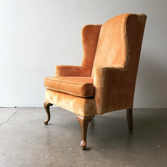 Vintage wingback pair covered in a peachy, sherbet orange velvet. Great pop of color! In excellent condition. Tag...