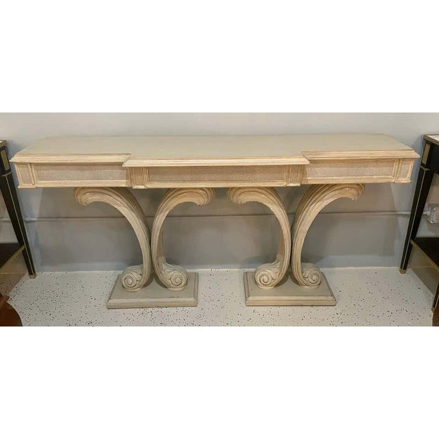 A Hollywood Regency Fleur de Lis double pedestal console table. Distressed paint decorated finish. Jansen style console....