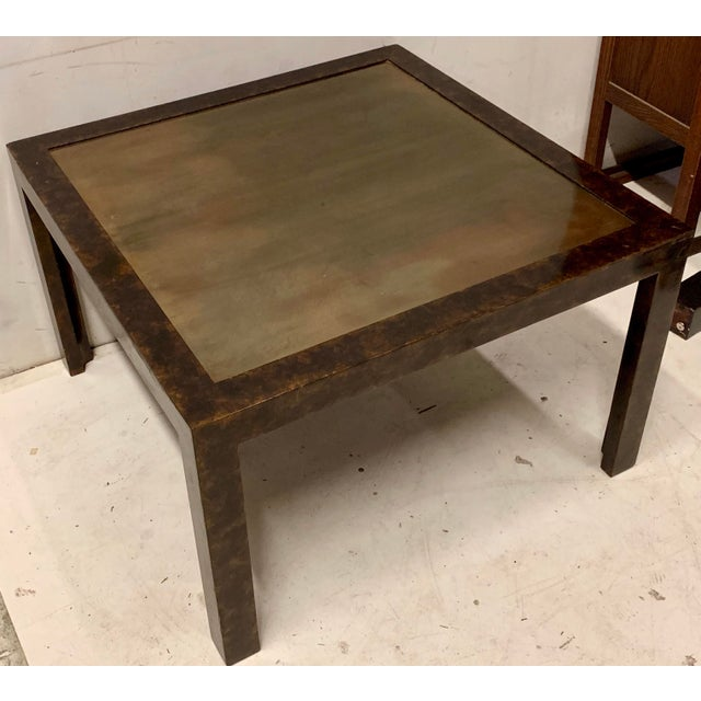 This is a John Widdicomb modern side table or coffee table with gilt metal top and faux tortoise finish. It is in very...