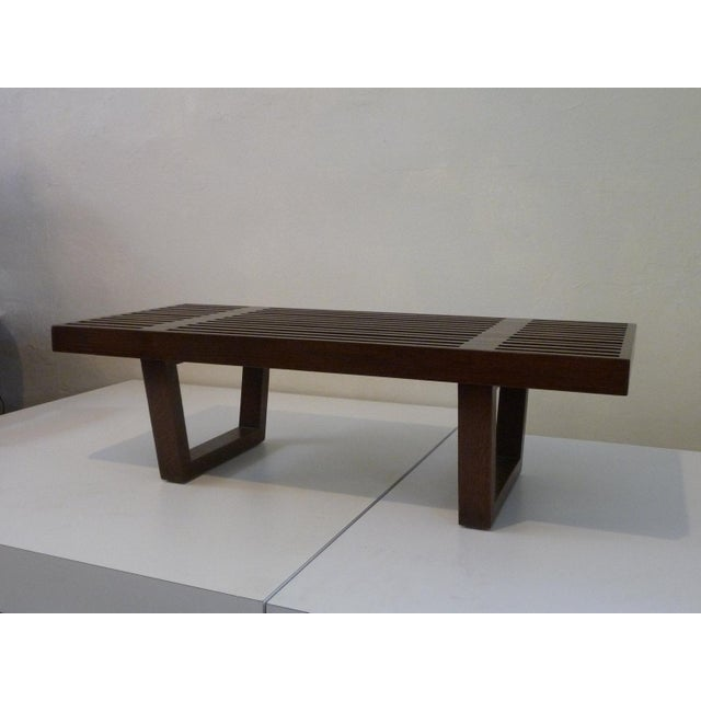 This piece was made in the style of the iconic George Nelson platform bench. It has a walnut finish with a slat top and...