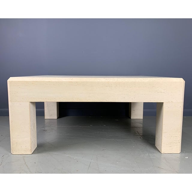 Impressive unhoned travertine coffee table, square in shape, will be an important addition to any room. This table...