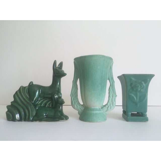 This collection of 3 pieces of rare vintage Art Deco 1930's Niloak rare multi tone green art pottery pieces is a very...