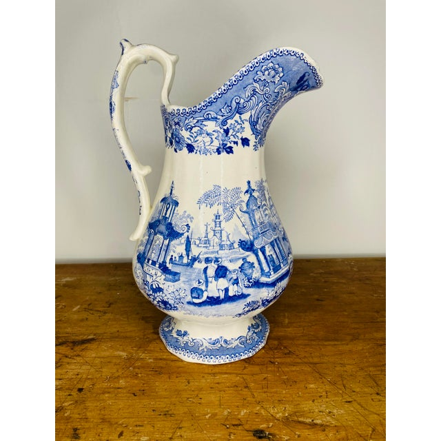 Very large, exceptional, Chinoiserie English transferware pitcher with fanciful pagodas, Asian figures and boats amongst...