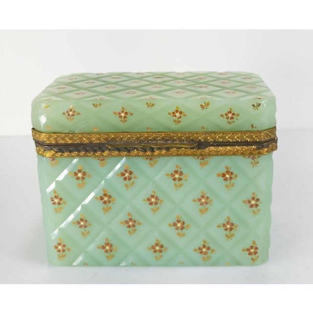 We are selling this fantastic and rare French opaline glass box. The box features striking and rare beautiful Celadon...
