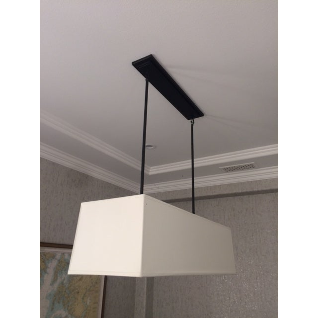 A gorgeous rectangular shade chandelier beautifully made, very solid piece. Has a bottom diffuser shields direct view fo...