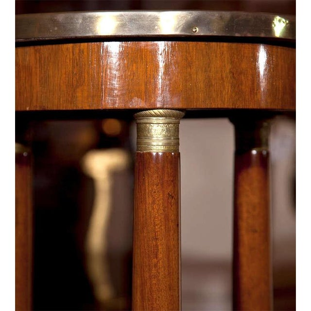 French Empire style mahogany pedestal, late 19th century, the grey veined circular marble with bronze banding, supported...