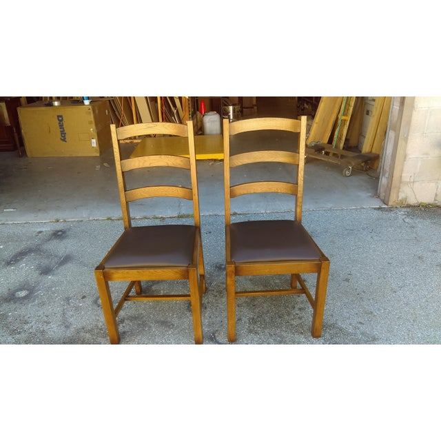 "A pair of ladder back chairs have their beauty in simple form and yet solid and steady chairs. Seat depth is 18"" to back..."