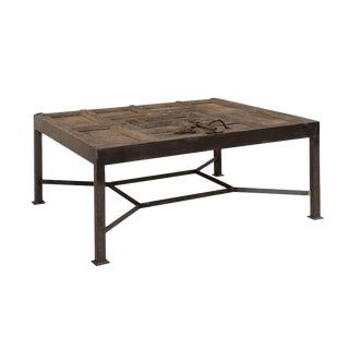 18th Century Spanish Door Fashioned Into Coffee Table With Metal Base For Sale