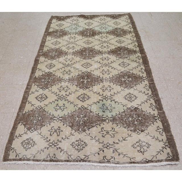Vintage Turkish Art Deco hand made rug with natural colors and unique geometric pattern.