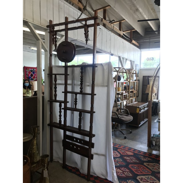 Rare and unusual room divider screen made with wood spindles, knobs, disks and framework. The pine framework is joined by...
