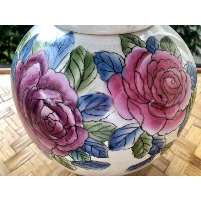 This charming and contemporary ginger jar is just too pretty! Hand decorated with pink and purple roses over an opalescent...
