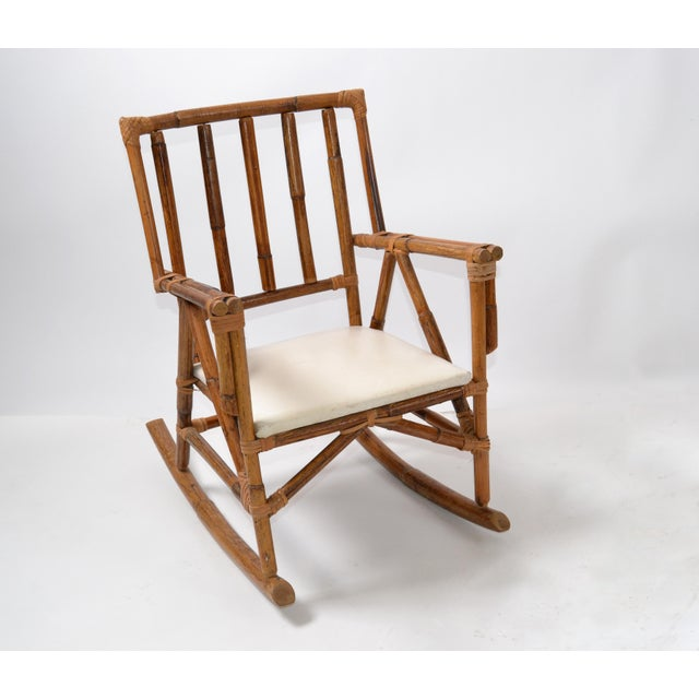 Cute Bohemian Bamboo & Vinyl Children Rocking Armchair. The chair is firm and sturdy, a fun item for Your Kids.