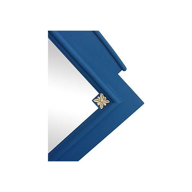 Rectangular mirror in a cobalt blue chalk finish and gilded accents. Minor wear. Hanging hardware included.