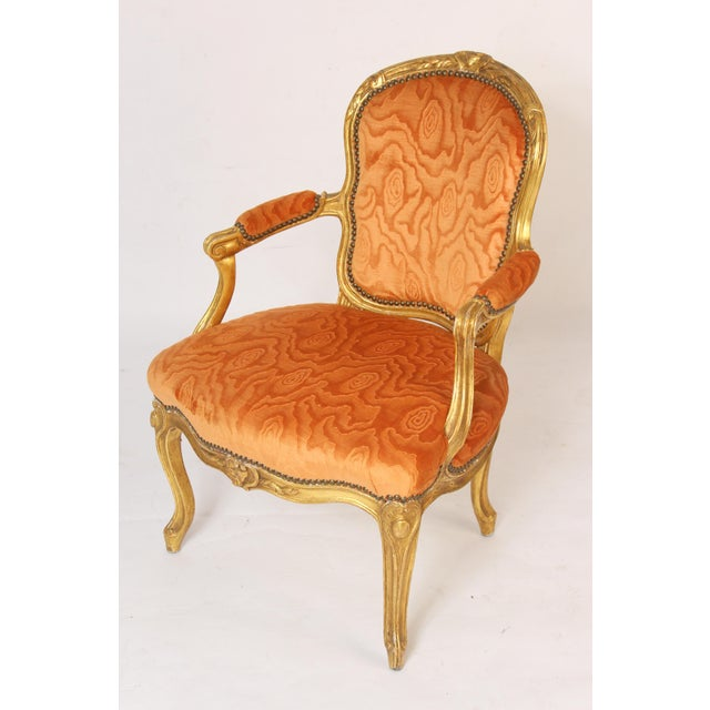 Pair of antique Louis XV style gilt wood armchairs, late 19th century. The gilding is either gold leaf or Dutch leaf. The...