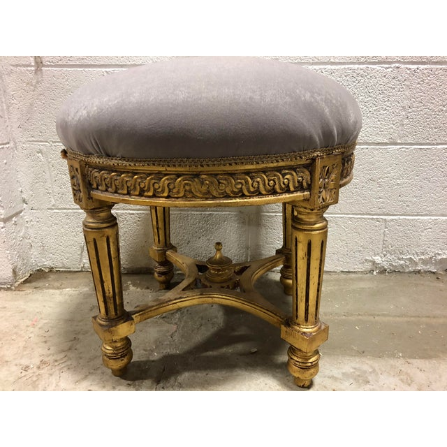 Vintage French ornate round bench in its original velvet fabric. Early 20th century piece and original upholstered top.
