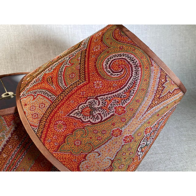 """A pair lampshades made from a circa 1880s wool paisley shawl. Measurements: top7"""" bottom 12"""" side 8"""""""