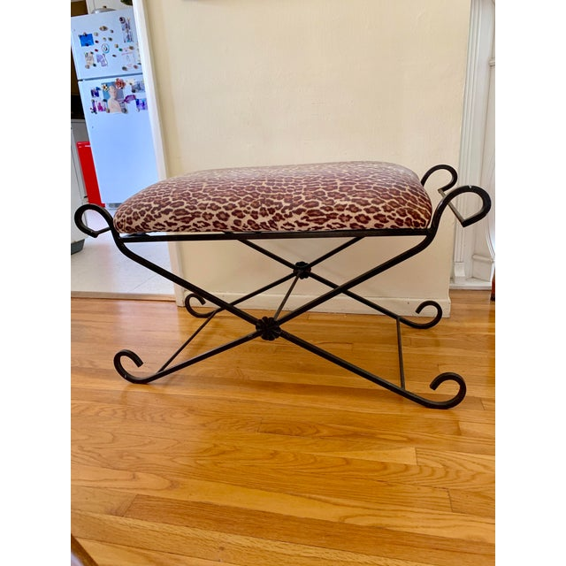 Rustic black iron bench with swirled elegant design and upholstered leopard velvet bench top. Perfect accent bench for any...