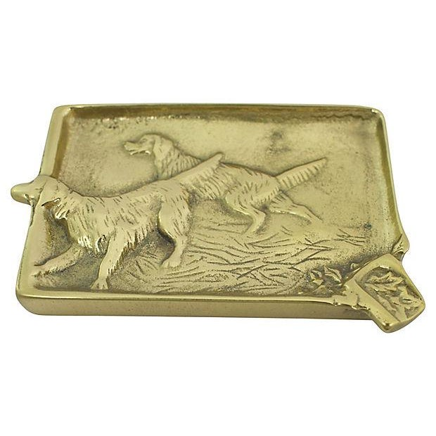 """1940s solid brass ashtray with English setter motif. Marked: """"3-2 Setter."""" Lightly tarnished."""