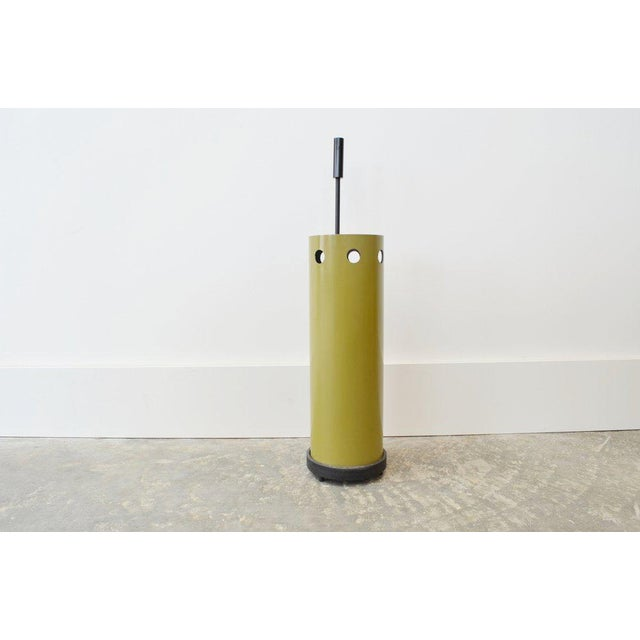 Midcentury umbrella stand with olive body and black accent designed by Floris Fiedeldij by Artimeta Soest.