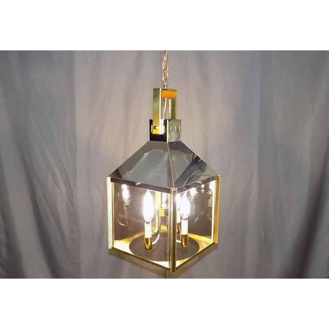 Vintage brass and chrome plated light fixture by Fredrick Ramond with smoked glass panels, retains original tag on ceiling...