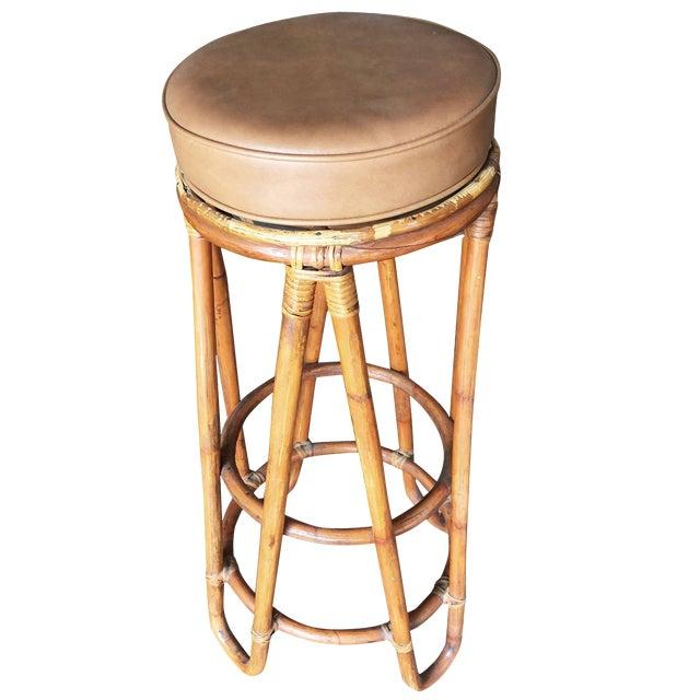 "Set of four 1950s bent leg ""Hair Pin"" Rattan bar stool with tan Naugahyde upholstery. Custom cushions C.O.M. (Customers..."