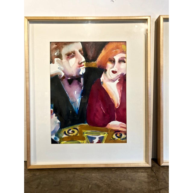 This a highly decorative pair of framed watercolors that detail cabaret life in the Deco era. The works are signed are...